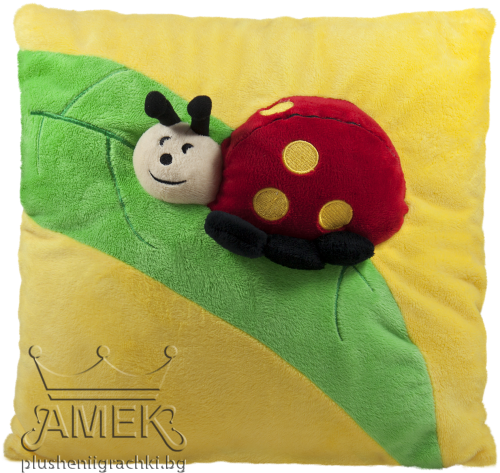 Yellow pillow with ladybug