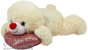 Bear lying on red heart
